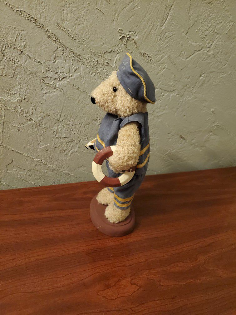 Nautical Bear Holding A Boat And Life Saver Floater