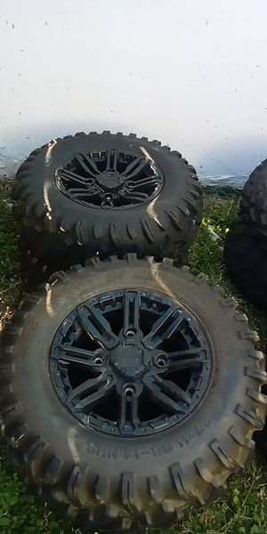 Photo Set of new polaris rims and tires barely used
