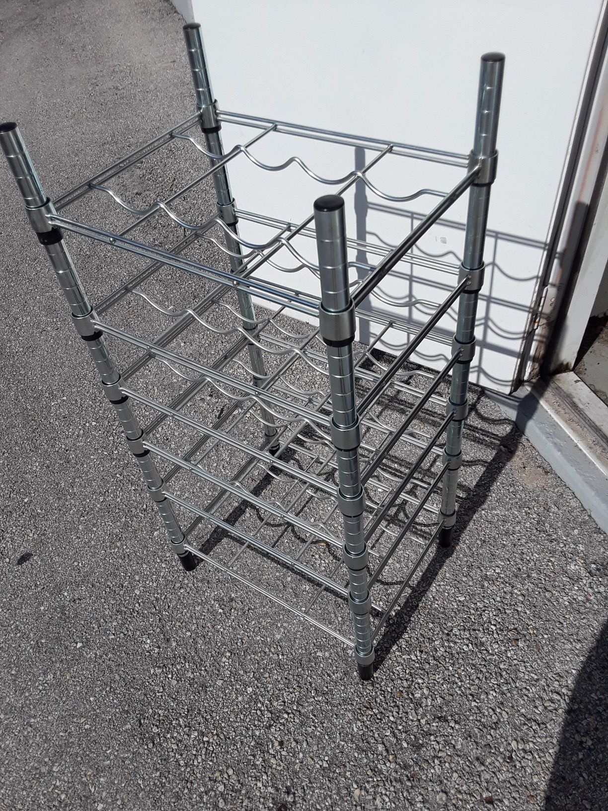 Stainless steel wine rake / shelf , fits 24 wine bottles