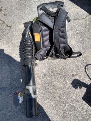 Photo Ryobi 2 cycle backpack blower, few available, all are missing the plastic nozzle that goes on the end of the handle