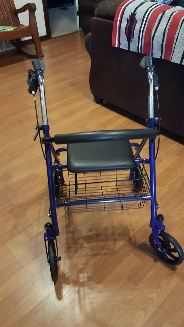 Rolling walker with a seat for Sale in Geronimo, OK - OfferUp