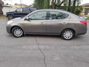 Photo SUPER CLEAN GAS SAVER 2014 NISSAN VERSA SV 80, MI CLEAN TITLE WITH SMOG CERTIFICATE AND CURRENT REGISTRATION WITH WITH NEW BREAKS AND TIRES