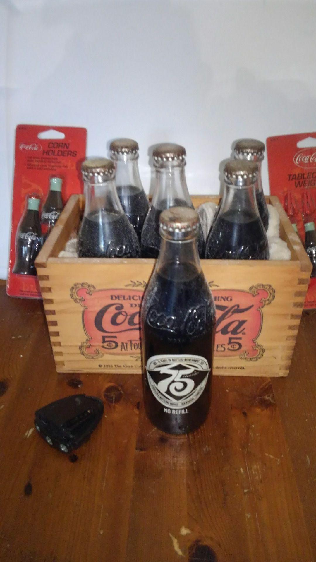 Antique coca cola anniversary bottles