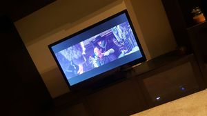 42 inch tv and TV wood and glass TV stand for Sale in Glen Allen, VA