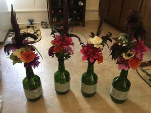 Wine bottles with flowers. Set of four. for Sale in Phenix, VA