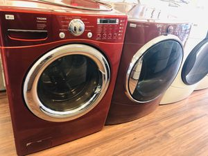 Photo Lg washer and maroon Kenmore elite dryer