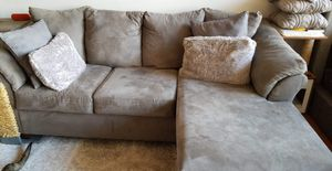 Photo Ashley Furniture Reversible Chaise Sectional