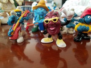 Smurf figurines and One Raisin for Sale in Gig Harbor, WA