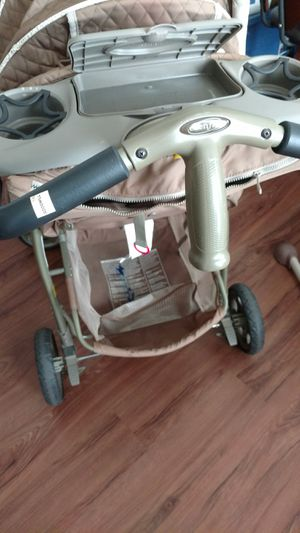 Even Flo stroller and musical rocking chair selling them together for Sale in Manassas, VA