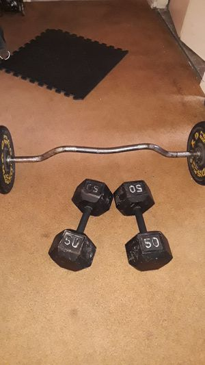 Exercise equip. Curl bar / 65 lbs plates / 2 50lbs dumbbells for Sale in Lincoln Acres, CA