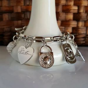 Mk Michael Kors charms bracelet jewelry for Sale in Silver Spring, MD