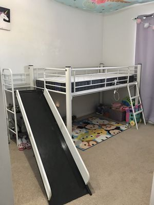 Photo Twin Loft bed with slide.
