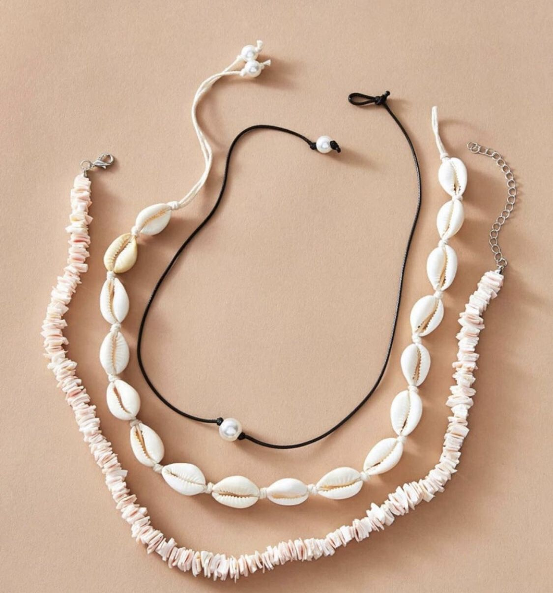 jewelry set : shell necklace, pearl bead, and another shell necklace