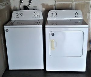 Photo Amana Washer and Dryer, one year old.