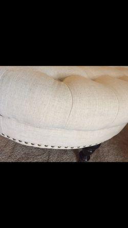 White round tufted ottoman. Thumbnail