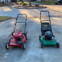 Two Running Lawn Mowers Thumbnail