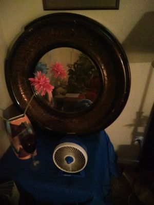 Circle cut mirror antique been around 3 generations, designer paint job beautiful piece of furniture great for living room or dining area for Sale in Modesto, CA