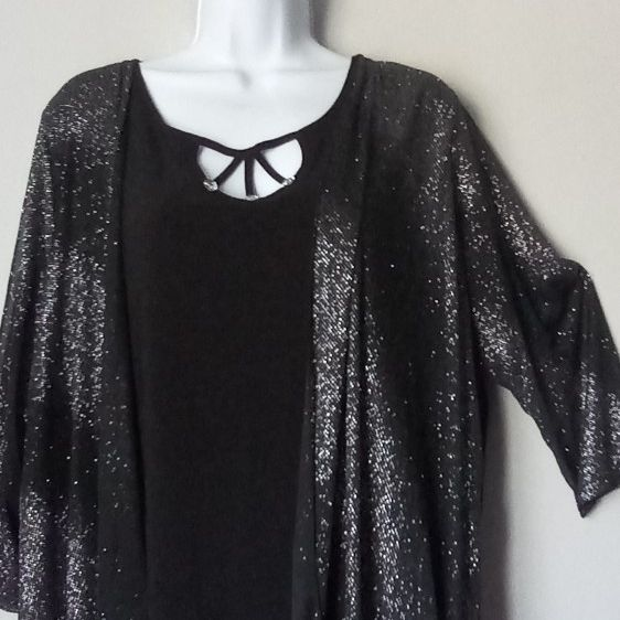 Black blouse with Glitter ,veil fabric on sleeves in size xL/1xL