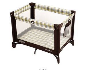 Photo Grace pack and play pen unisex green brown stripes