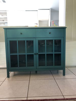 Photo Teal glass front cabinet