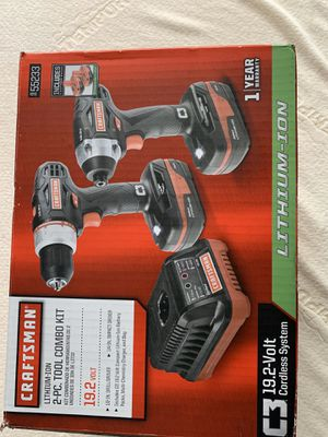 Photo 2 piece Lithium-Ion combo Drill Driver with Impact driver with 2 batteries and one charger. BRAND NEW in the box