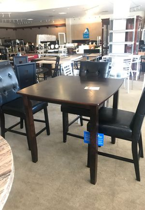 Photo Counter Height wood table with 4 chairs