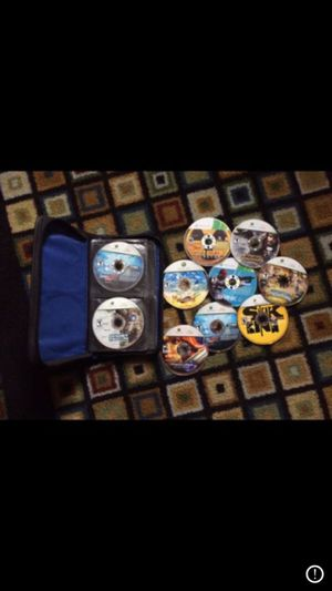 Photo Large lot of various x-box 360 video games w carry case