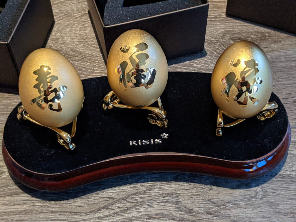 Chinese RISIS Golden Wealth Collection real eggshells encapsulated in 24K Swiss Gold. $688 retail. Includes set of 3 gold eggs. Brand New condition.