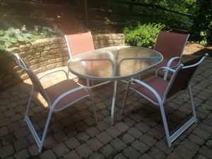 Outdoor Oval table and 4 chairs for Sale in Potomac Falls, VA