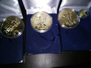 Half pound 24k gold and silver coins for Sale in Seattle, WA