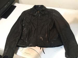 Photo Ladies Harley Davidson leather jacket, vest , and chaps.