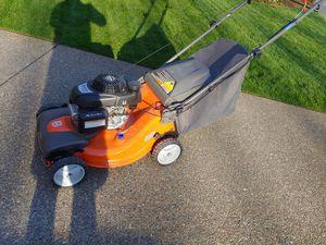 Photo New Husqvarna all-wheel-drive self-propelled lawn mower with Honda engine