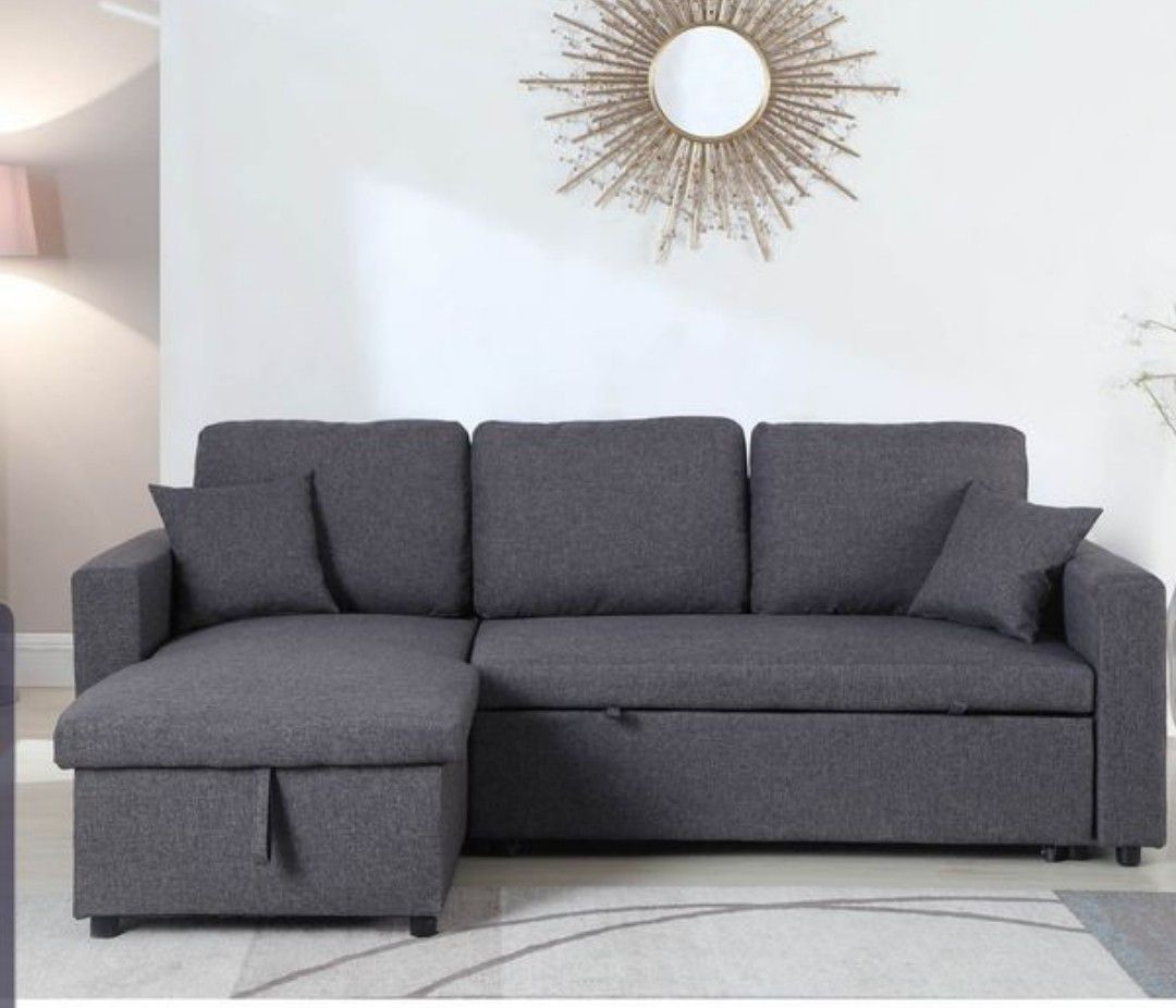 Grey sectional sofa pull out bed & storage chaise