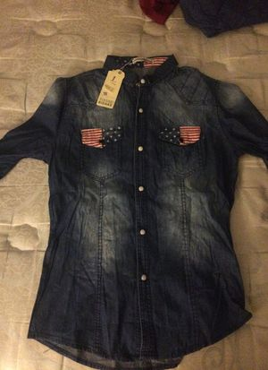 Brand new denim shirt with American flag pockets for Sale in Frederick, MD