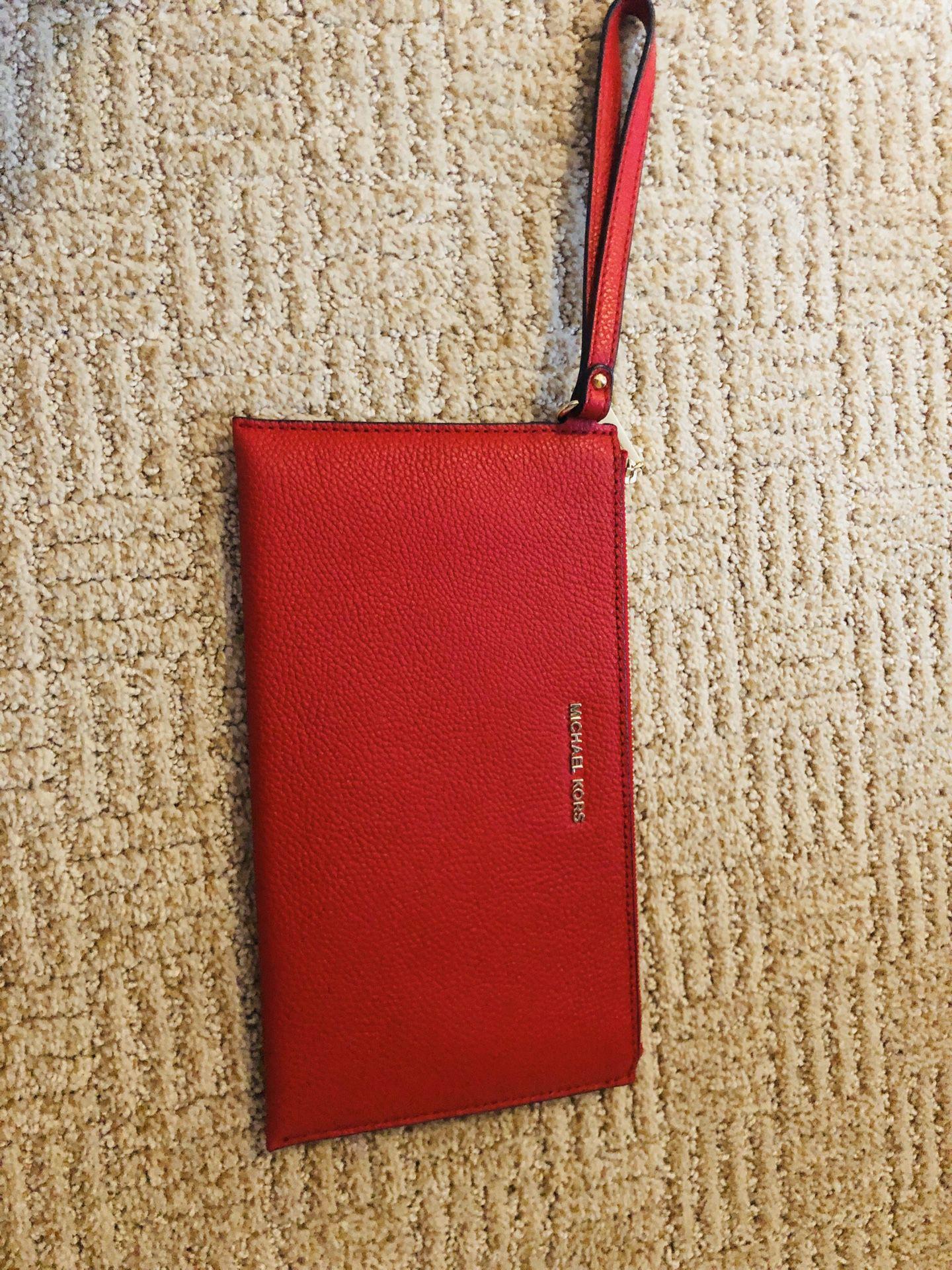 Michael Kors read wristlet/pouch