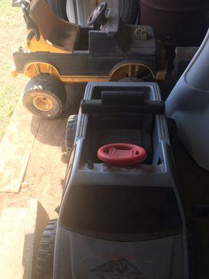 Photo Two power wheels. Muffler for a 09 Dodge Ram. Kerosene heater