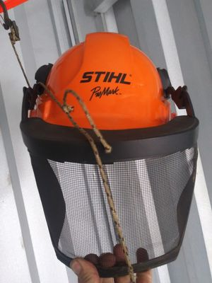 Photo Stihl hard hat with shield and 2 stihl chainsaw pants 125 for all