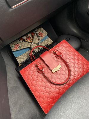 Photo Gucci bags both retired. We're my ex chicks well worth over 10k as of now. Offer up. Red one got the matching wallet jacked so that bags pric