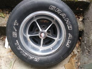 Stock Pontiac rims and tires for Sale in Spanaway, WA