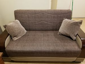 A Sofa And Love Seat That S Turn Into Futons Bed For In Newark Nj
