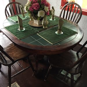 Green ceramic and wood mahogany table with 4 chairs for Sale in Arrington, VA