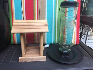 Light green glass bird 🐦 feeder and wooden bird /squirrel 🐿feeder for Sale in Shoreline, WA