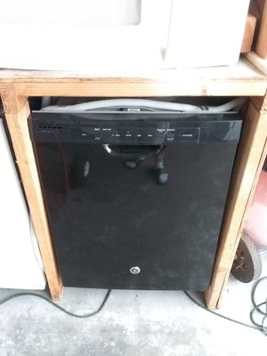 Photo Black ge dishwasher with plastic tub in excellent working condition