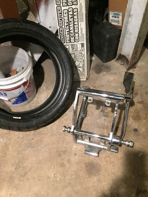 Chrome swing arm for soft tail with axle for 200 tire and new 200 tire for Sale in St. Louis, MO