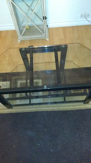 Glass and Metal TV stand 3 Shelf just like new must pick up I have no way to deliver for Sale in San Antonio, TX