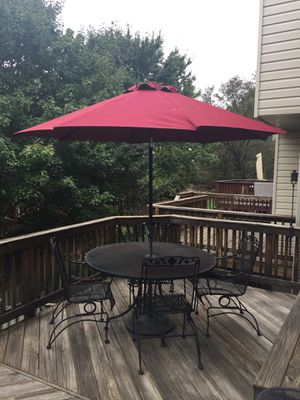 Wrought iron patio table with 6 chairs, cushions, and umbrella with stand for Sale in Alexandria, VA