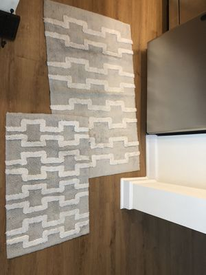 Two matching grey pattern bathroom rugs for Sale in Fairfax, VA