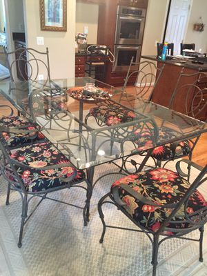 Glass table with 6 chairs seat covers easily changed for Sale in Centreville, VA