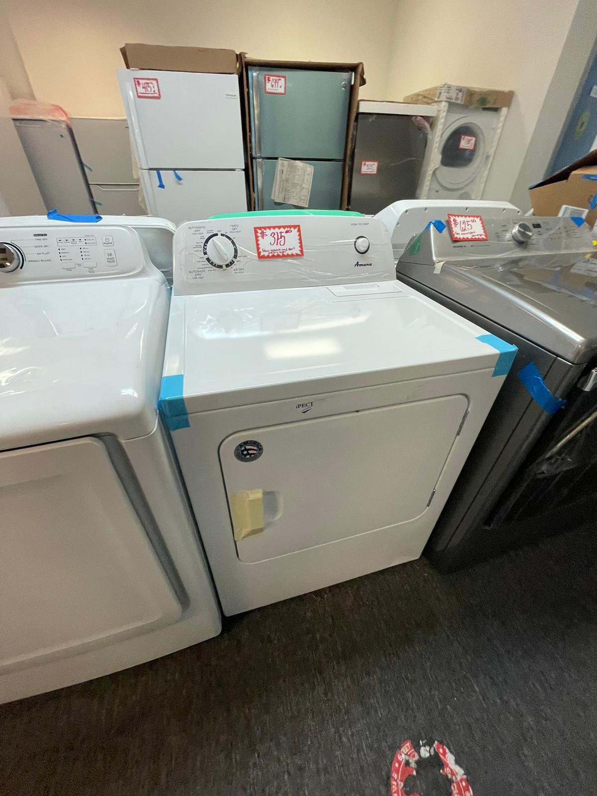 New Amana electric dryer scratched and dented with warranty