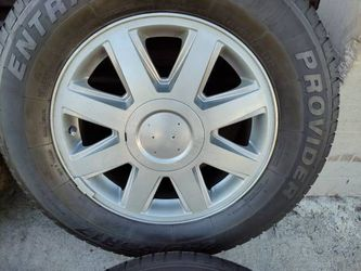 17 inch rims and caps with tires. Buick Ranier, trailblazer or Envoy  Thumbnail